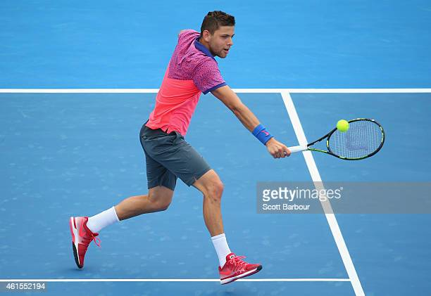 Filip Krajinovic of Serbia plays a backhand during his match against Gilles Simon of France during day three of the 2015 Priceline Pharmacy Classic...