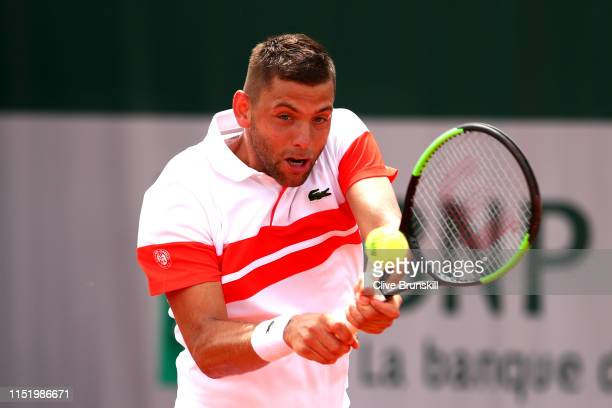 Filip Krajinovic of Serbia plays a backhand during his mens singles first round match against Frances Tiafoe of The United States during Day two of...