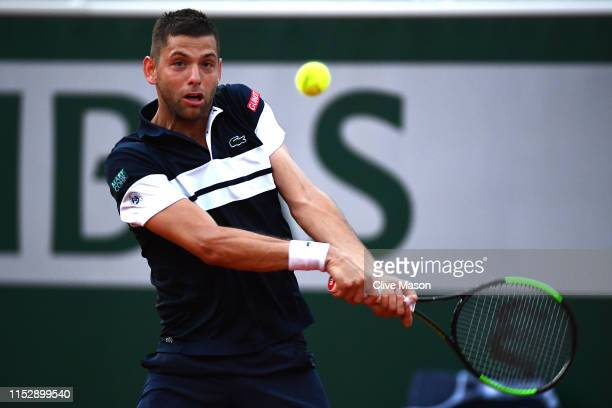 Filip Krajinovic of Serbia plays a backhand during his mens singles third round match against Stefanos Tsitsipas of Greece during Day six of the 2019...