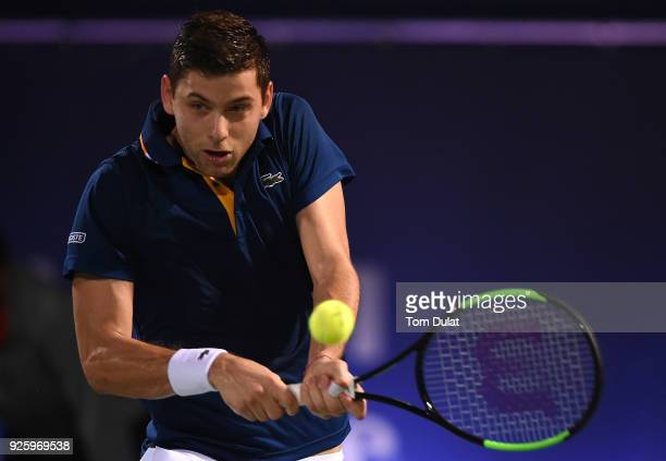 Filip Krajinovic of Serbia plays a backhand during his quarter final match against Evgeny Donskoy of Russia on day four of the ATP Dubai Duty Free...