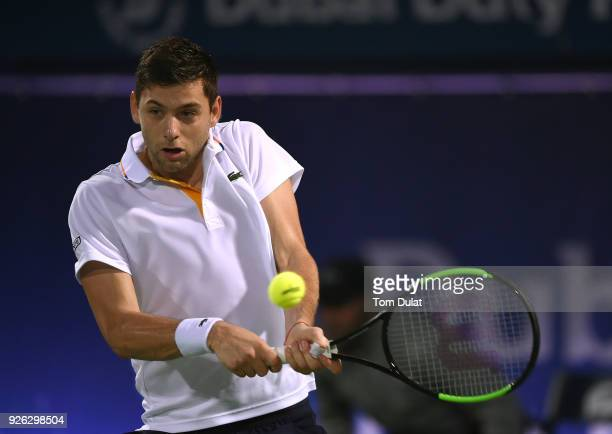 Filip Krajinovic of Serbia plays a backhand during his semi final match against Lucas Pouille of France on day five of the ATP Dubai Duty Free Tennis...