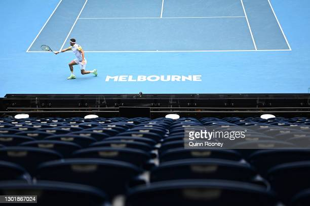 Filip Krajinovic of Serbia plays a backhand in his Men's Singles third round match against Daniil Medvedev of Russia during day six of the 2021...