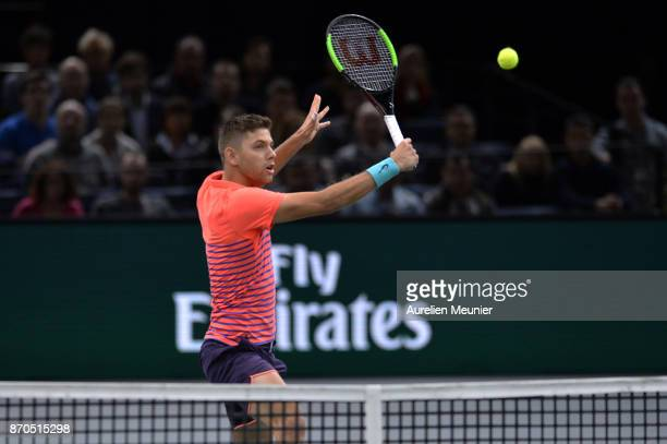 Filip Krajinovic of Serbia plays a backhand in the men's singles final match against Jack sock of the United States of America during day seven of...