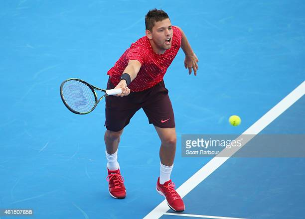 Filip Krajinovic of Serbia plays a forehand during his match against Alexandr Dolgopolov of Ukraine during day two of the Priceline Pharmacy Classic...