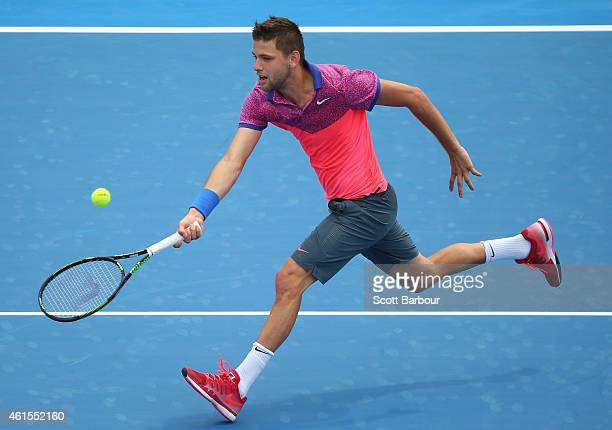 Filip Krajinovic of Serbia plays a forehand during his match against Gilles Simon of France during day three of the 2015 Priceline Pharmacy Classic...