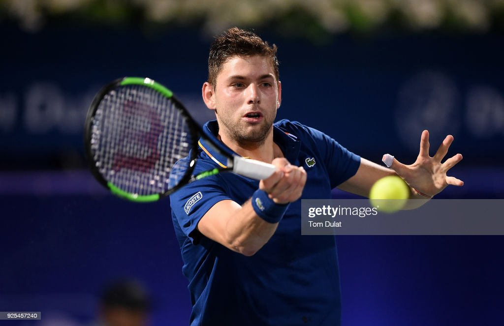 Filip Krajinovic of Serbia plays a forehand during his match against Marcos Baghdatis of Cyprus on day three of the ATP Dubai Duty Free Tennis Championships at the Dubai Duty Free Stadium on February 28, 2018 in Dubai, United Arab Emirates.
