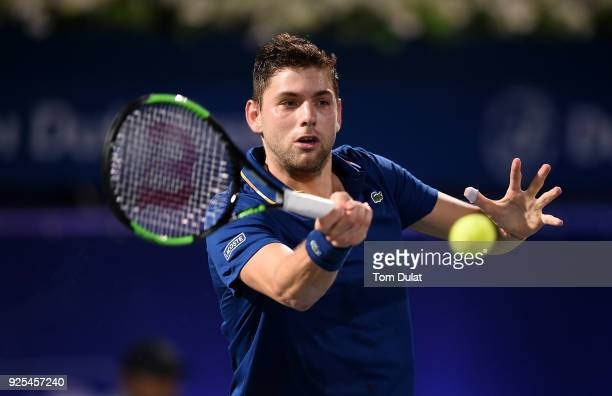 Filip Krajinovic of Serbia plays a forehand during his match against Marcos Baghdatis of Cyprus on day three of the ATP Dubai Duty Free Tennis...