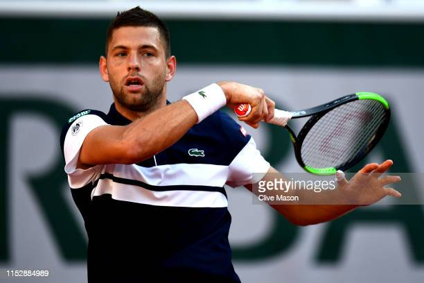 Filip Krajinovic of Serbia plays a forehand during his mens singles third round match against Stefanos Tsitsipas of Greece during Day six of the 2019...