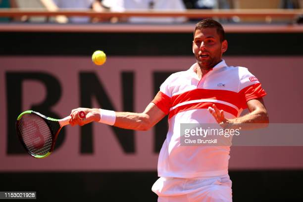 Filip Krajinovic of Serbia plays a forehand during his mens singles third round match against Stefanos Tsitsipas of Greece during Day seven of the...
