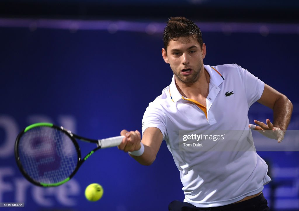 Filip Krajinovic of Serbia plays a forehand during his semi final match against Lucas Pouille of France on day five of the ATP Dubai Duty Free Tennis Championships at the Dubai Duty Free Stadium on March 2, 2018 in Dubai, United Arab Emirates