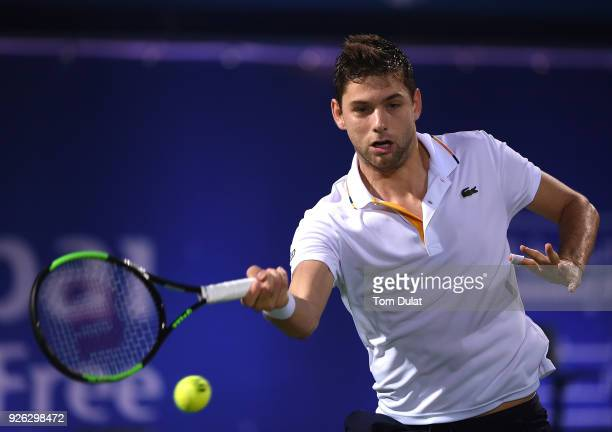Filip Krajinovic of Serbia plays a forehand during his semi final match against Lucas Pouille of France on day five of the ATP Dubai Duty Free Tennis...