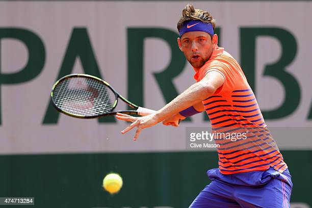Filip Krajinovic of Serbia plays a forehand in his Men's Singles match against David Goffin of Belgium on day two of the 2015 French Open at Roland...