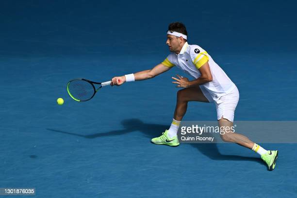 Filip Krajinovic of Serbia plays a forehand in his Men's Singles third round match against Daniil Medvedev of Russia during day six of the 2021...