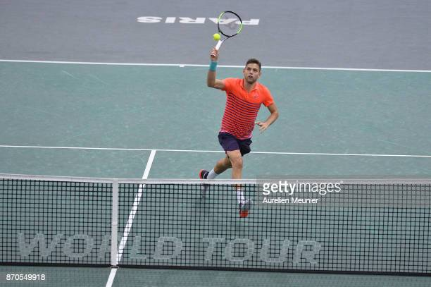 Filip Krajinovic of Serbia plays a forehand in the men's singles final match against Jack sock of the United States of America during day seven of...