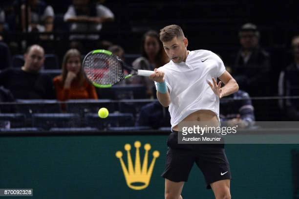 Filip Krajinovic of Serbia plays a forehand in the men's singles semi final match against John Isner of the United States of America during day six...