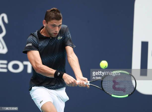 Filip Krajinovic of Serbia plays a point against Roger Federer of Switzerland during day 8 of the Miami Open presented by Itau at Hard Rock Stadium...