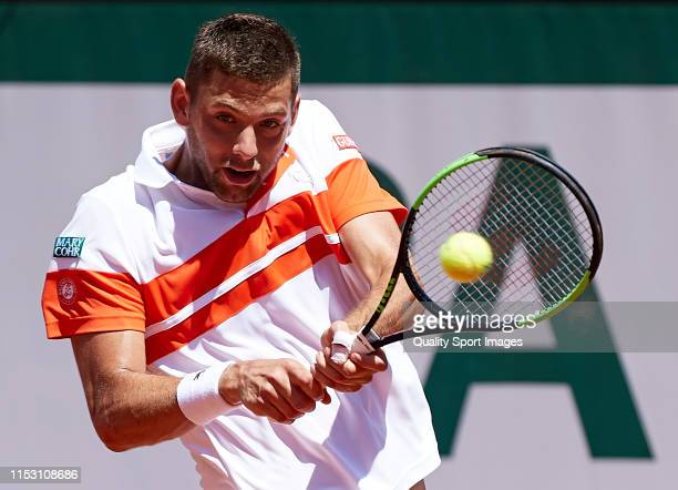 Filip Krajinovic of Serbia returns a ball in his mens singles third round match against Stefanos Tsitsipas of Greece during Day seven of the 2019...