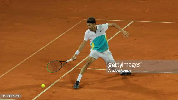 Filip Krajinovic of Serbia returns the ball to Dominic Thiem of Austria during final match in the Serbian leg of Adria Tour a charity exhibition...