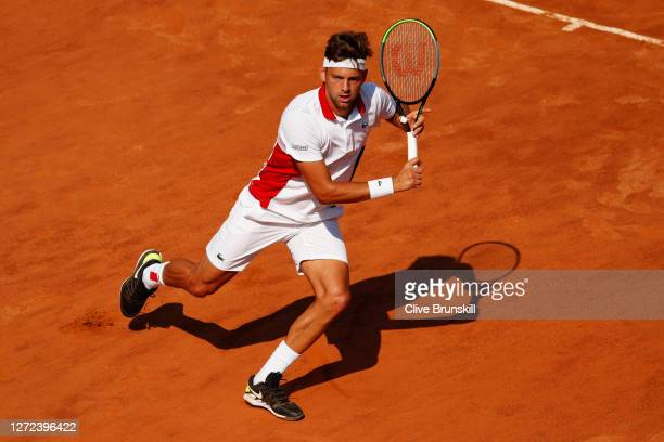 Filip Krajinovic of Serbia runs to play a backhand in his round one match against Felix AugerAliassime of Canada during day one of the Internazionali...
