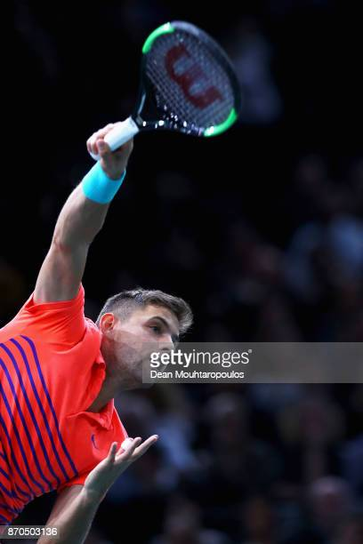 Filip Krajinovic of Serbia serves against Jack Sock of the USA during the Mens Final on day 7 of the Rolex Paris Masters held at the AccorHotels...