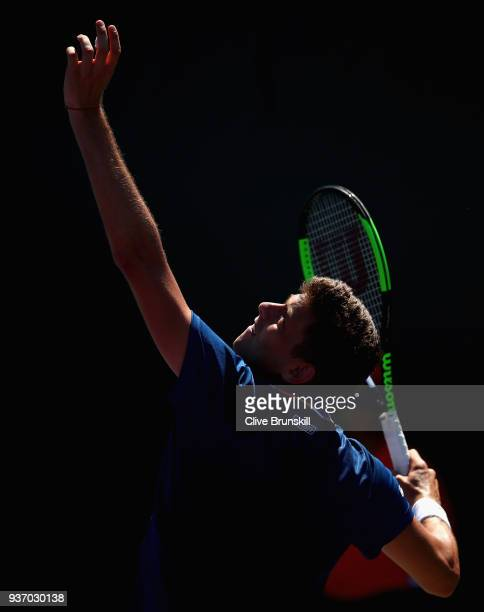 Filip Krajinovic of Serbia serves against Liam Broady of Great Britain in their second round match during the Miami Open Presented by Itau at Crandon...