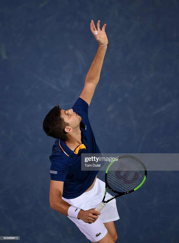 Filip Krajinovic of Serbia serves during his quarter final match against Evgeny Donskoy of Russia on day four of the ATP Dubai Duty Free Tennis Championships at the Dubai Duty Free Stadium on March 1, 2018 in Dubai, United Arab Emirates.