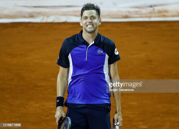 Filip Krajinovic of Serbia smiles after winning the match against Novak Djokovic of Serbia after the Adria Tour charity exhibition hosted by Novak...