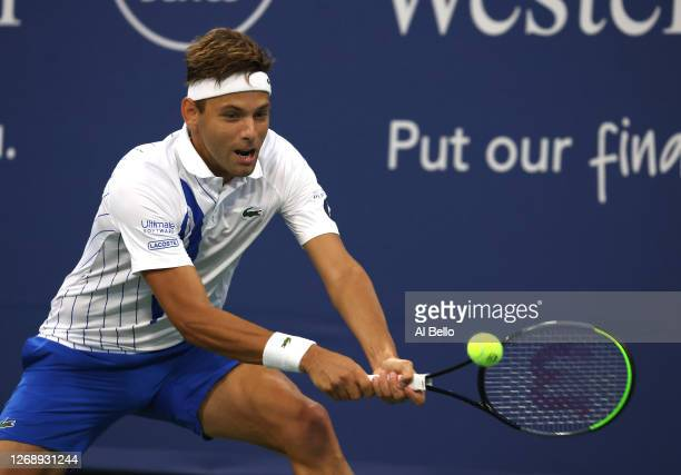 Filip Kranjinovic of Serbia returns a shot against Milos Ranic of Canada during the Western Southern Open at the USTA Billie Jean King National...