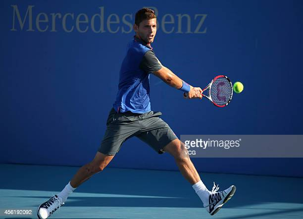 Filip Kranjinovic of Serbia returns a shot against Ricardas Berankis of Lithuania during day one of the China Open at the China National Tennis...