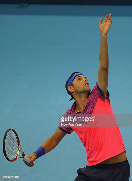Filip Kranjinovic of Serbia serves against Julien Benneteau of France during the Malaysian Open at Putra Stadium on September 24 2014 in Kuala Lumpur...