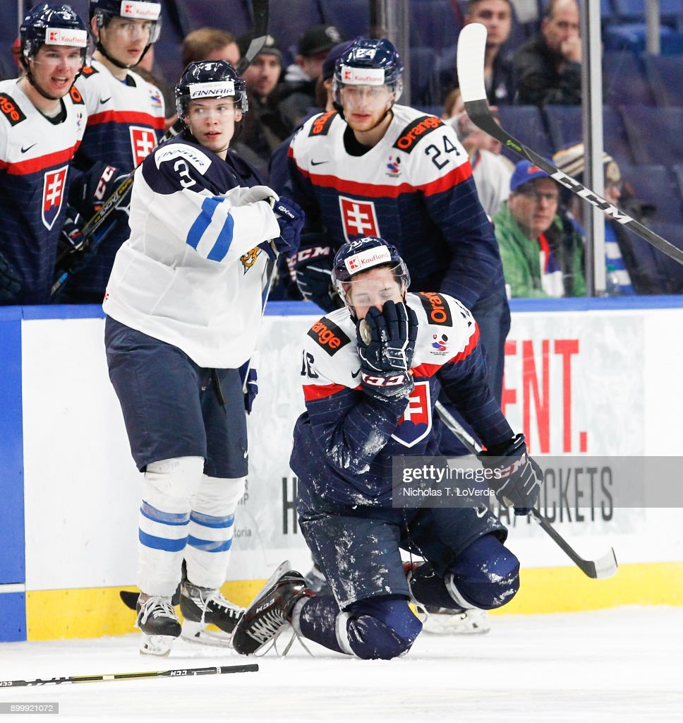 Filip Krivosik #16 of Slovakia took a high stick to the face from Juha Jääskä #3 of Finland during the third period of play in the IIHF World Junior Championships at the KeyBank Center on December 30, 2017 in Buffalo, New York.