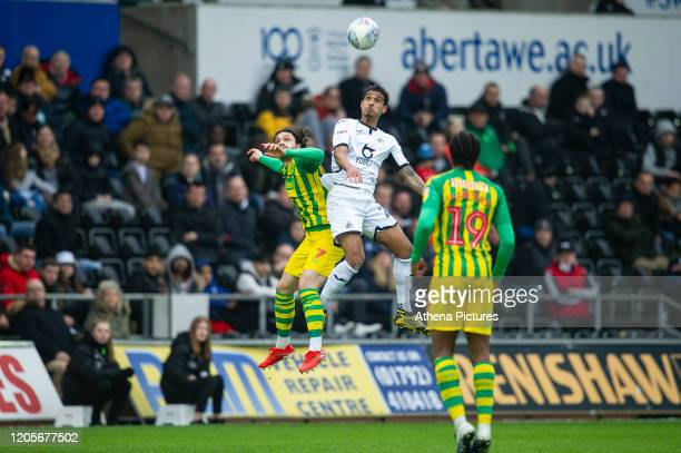 Filip Krovinovi of West Bromwich Albion battles with Kyle Naughton of Swansea City during the Sky Bet Championship match between Swansea City and...