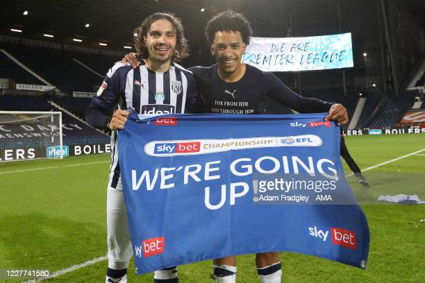 Filip Krovinovic and Matheus Pereira of West Bromwich Albion as they celebrate promotion to the Premier League on the pitch at the end of the Sky Bet...