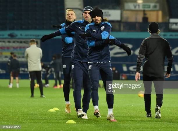 Filip Krovinovic, Branislav Ivanovic and Kamil Grosicki of West Bromwich Albion warm up prior to the Premier League match between West Bromwich...