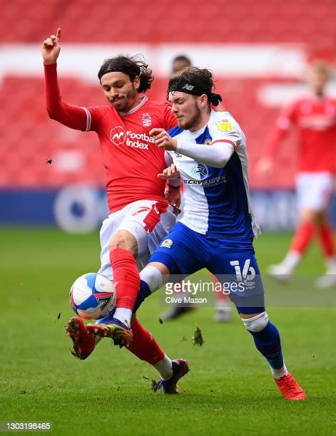 Filip Krovinovic of Nottingham Forest battles for possession with Harvey Elliott of Blackburn Rovers during the Sky Bet Championship match between...