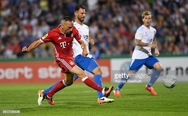 Filip Krstic of Jena is challenged by Franck Ribery of Munich during the DFB Cup match between FC Carl Zeiss Jena and Bayern Muenchen at...