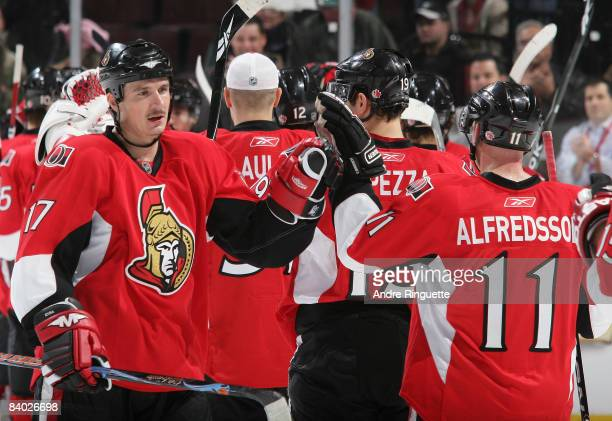 Filip Kuba and Daniel Alfredsson of the Ottawa Senators high five each other after their win against the Tampa Bay Lightning at Scotiabank Place on...