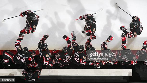 Filip Kuba Daniel Alfredsson and Alexandre Picard of the Ottawa Senators celebrate a goal at the players' bench against the Florida Panthers at...