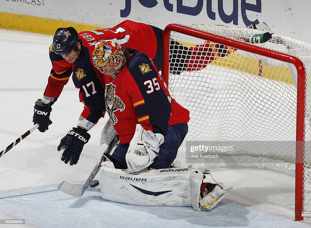 Filip Kuba #17 dives towards the net as goaltender Jacob Markstrom #35 of the Florida Panthers stops a shot by the Winnipeg Jets during the overtime period at the BB&T Center on March 8, 2013 in Sunrise, Florida.