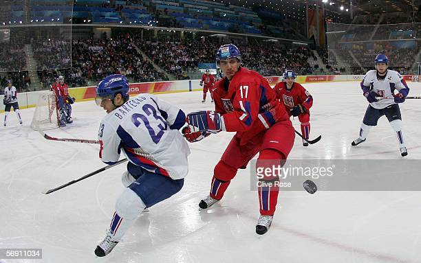 Filip Kuba of Czech Republic andd Lubos Bartecko of Slovakia look at the puck uring the quarter final of the men's ice hockey match between Slovakia...