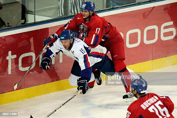 Filip Kuba of Czech Republic pushes Jozef Syumpel of Slovakia down towards the ice during the quarter final of the men's ice hockey match between...
