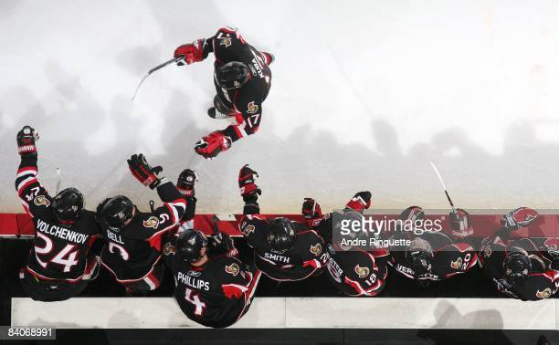 Filip Kuba of the Ottawa Senators celebrates a goal against the Florida Panthers at the players' bench at Scotiabank Place on December 8 2008 in...