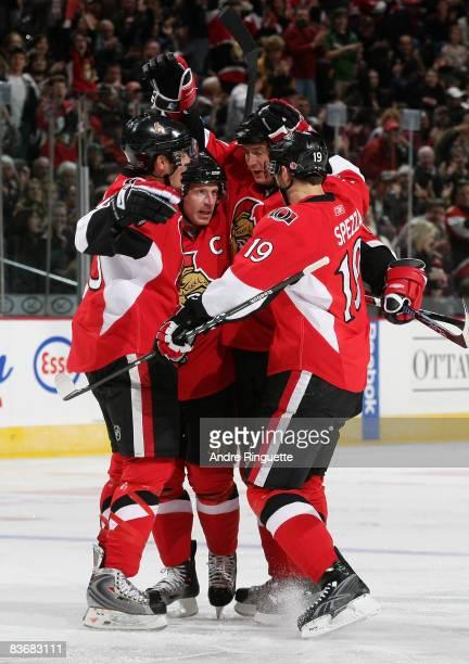 Filip Kuba of the Ottawa Senators celebrates his first period power play goal against the New York Islanders with Alexandre Picard Daniel Alfredsson...