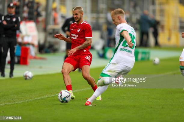 Filip Kusi of Türkgücü Munich and Timo Baumgartl of Union Berlin in action during the DFB Cup first round match between Türkgücü Munich and 1. FC...
