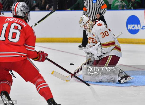 Filip Larsson of the Denver Pioneers blocks a shot a Quinn Preston of the Ohio State Buckeyes looks on during an NCAA Division I Men's Ice Hockey...