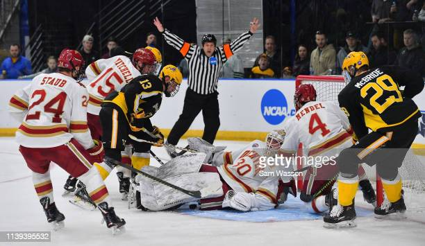 Filip Larsson of the Denver Pioneers lays on the puck in front of the net during the NCAA Division I Men's Ice Hockey West Regional Championship...