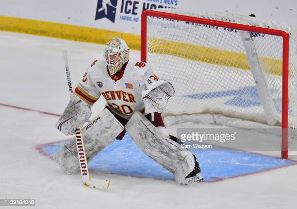 Filip Larsson of the Denver Pioneers tends net against the Ohio State Buckeyes during an NCAA Division I Men's Ice Hockey West Regional Championship...