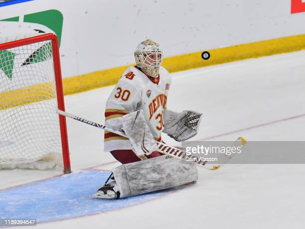 Filip Larsson of the Denver Pioneers watches the puck in the air during the NCAA Division I Men's Ice Hockey West Regional Championship Final against...