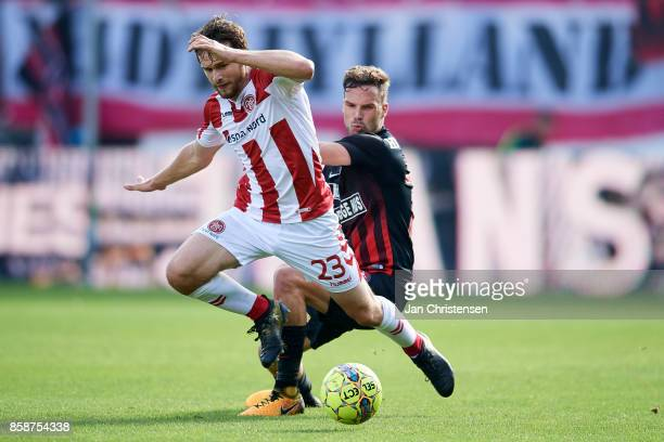 Filip Lesniak of AaB Aalborg and Filip Novak of FC Midtjylland compete for the ball during the Danish Alka Superliga match between FC Midtjylland and...