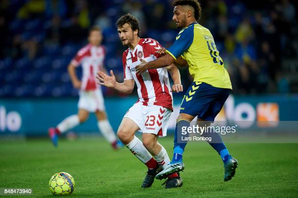 Filip Lesniak of AaB Aalborg and Hany Mukhtar of Brondby IF compete for the ball during the Danish Alka Superliga match between Brondby IF and AaB...